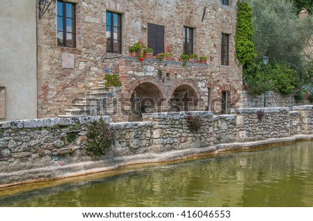 Thermal baths in the medieval village Bagno Vignoni, Tuscany, Italy - spa basin in the antique italian town. - stock photo