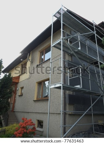 Thermal insulation of building by styrofoam - stock photo
