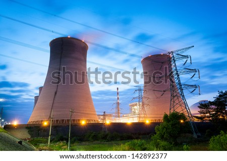 Thermal power plant at night - stock photo
