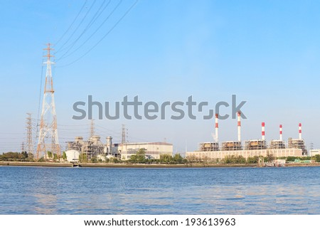 Thermal  Power  Plant beside river side location use for industry and power energy producing and  multipipurpose topic - stock photo