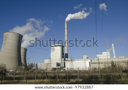 thermal power plant with chimneys - stock photo