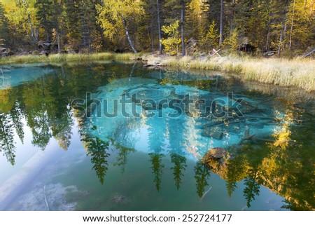 Thermal spring lake, geysir Lake, geyser bassin, Altai, Siberia - stock photo