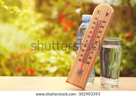 Thermometer on summer day showing high temperature near 45 degrees - stock photo