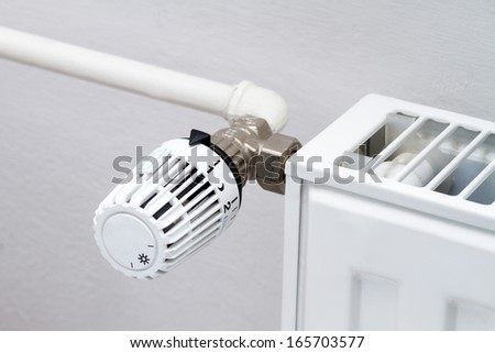 thermostat on a heating radiator - stock photo