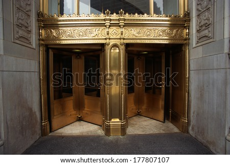 These are the golden front doors to the Wrigley Building.  - stock photo