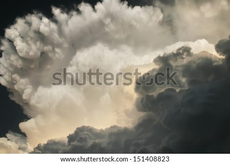These dark and dramatic thunderstorm clouds developed directly overhead on a hot and humid Kansas summer afternoon, a heavy storm and tornado warning soon followed. - stock photo