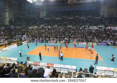 THESSALONIKI, GREECE, APRIL 23, 2015: General view of the players in action on the net during the Hellenic Volleyball League final games Paok vs Olympiacos at PAOK Sports Arena. - stock photo