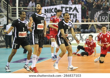 THESSALONIKI, GREECE, APRIL 23, 2015: Jimenez, Rangel and Gomez celebrate their point during the Hellenic Volleyball League final games Paok vs Olympiacos at PAOK Sports Arena. - stock photo