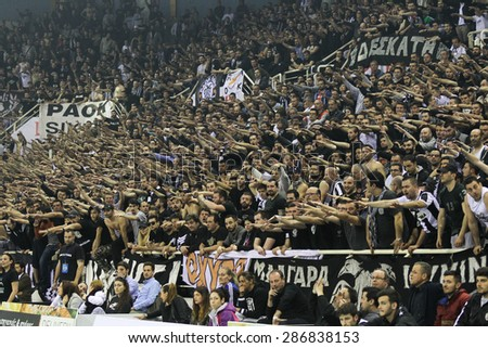 THESSALONIKI, GREECE, APRIL 23, 2015: Paok fans cheer for their team during the Hellenic Volleyball League final games Paok vs Olympiacos at PAOK Sports Arena. - stock photo