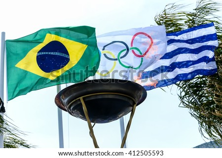 Thessaloniki, Greece - April 22, 2016: The Olympic Flame and the flags of the Olympics, Brazil and Greece. Arrival of the Olympic Flame of XXXI Summer Olympic Games Rio 2016  in Thessaloniki - stock photo