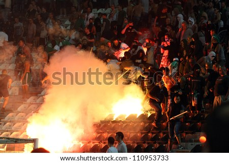 THESSALONIKI, GREECE-AUG 23:Clashes PAOK Thessaloniki and Rapid Vienna fans and the police before UEFA Europe League Playoff Football Match at Toumba Stadium on August 23, 2012 in Thessaloniki,Greece. - stock photo