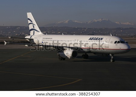 Thessaloniki, Greece - February 9, 2016. Aegean Airlines Airbus A320 on the tarmac going to park after landing in Makedonia International Airport. Olympus mountain on the background - stock photo