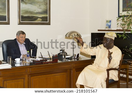 THESSALONIKI, GREECE- JULY 25, 2014: Panagiotis Papadopoulos during the visit of Ambassador of the Federal Republic of Nigeria L. Ayodele Ayodeji at the Industrial Chamber of Thessaloniki, Greece.  - stock photo