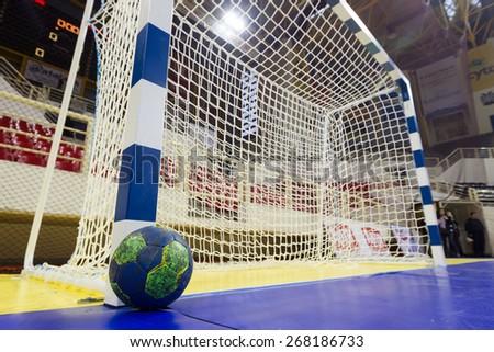THESSALONIKI, GREECE, MARCH 27, 2015: Handball ball next to the goalpost prior to the Greek Women Cup Final handball game  Paok vs Nea Ionia - stock photo