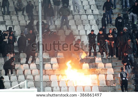 THESSALONIKI, GREECE - MARCH 02, 2016: PAOK fans put fire in the stands during clashes with riot police at the semifinal Greek Cup game between PAOK and Olympiacos played at Toumba stadium - stock photo