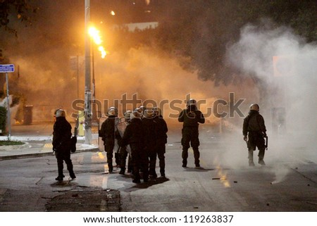 THESSALONIKI,GREECE - NOVEMBER,17 : Police officers attack demonstrators during a violent demonstrations marking the anniversary of the 1973 on Nov 17, 2012 in Thessaloniki, Greece. - stock photo