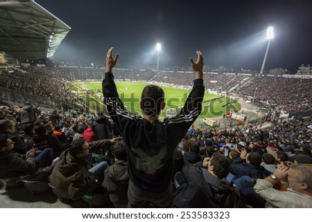 THESSALONIKI, GREECE NOVEMBER 9, 2014 : View of the Toumba Stadium full of fans and supporters of PAOK who light flares  during the Greek Superleague match PAOK vs Panathinaikos - stock photo