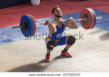 Thessaloniki, Greece, Oct 2 2015: Unknown athlete in his attempt to lift the weights during the course of the Greek Weightlifting Championship - stock photo