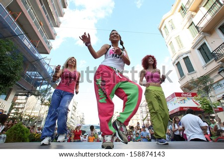 THESSALONIKI, GREECE - SEPT 22 : People perform Zumba dance training during the Day without Car outdoor activities on September 22, 2013, in Thessaloniki, Greece. - stock photo