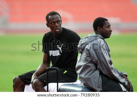 THESSALONIKI, GREECE -SEPTEMBER 11:Jamaican U. Bolt (L) relaxing in the training center for the IAAF World Athletics Finals main event in Kaftatzoglio Stadium on September 11, 2009 in Thessaloniki,Greece - stock photo