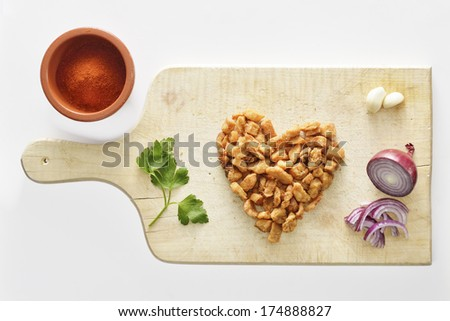 """They say """"a way to a man's heart is through his stomach"""". Perhaps some crisp pork rinds will do the trick? - stock photo"""