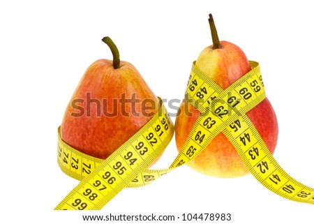 Thick and harmonous fruits with tape measure on  waist isolated on a white background. A concept - a fruit diet and fight against excess weight. - stock photo