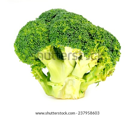 Thick, juicy, organic, green broccoli head sliced on white - stock photo