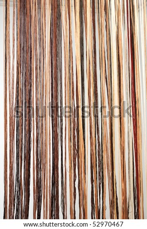 thick multicolored threads strained in the loom - stock photo