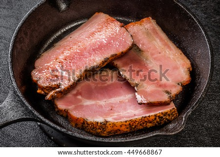 Thick slice bacon and iron frying pan - stock photo