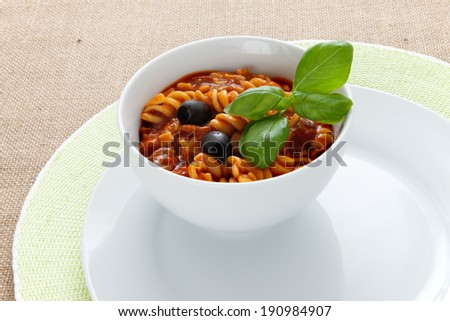 Thick soup with pasta and tomatoes - stock photo