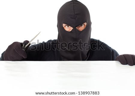 Thief capped with a knife and the white bottom - stock photo