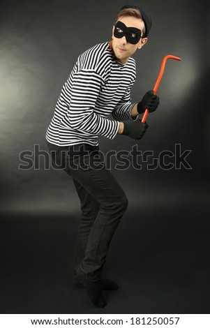 Thief on dark background - stock photo