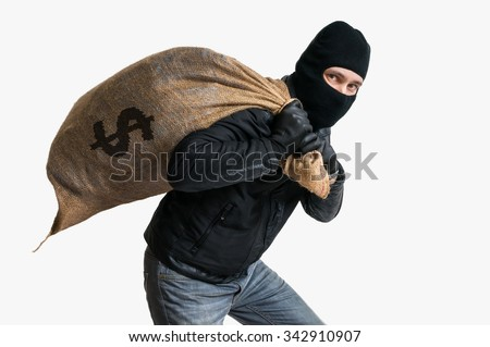 Thief robbed bank and is carrying full bag of money. Isolated on white background. - stock photo