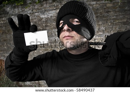 Thief showing his visit card, editable - stock photo
