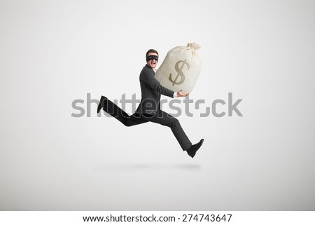 thief stole the bag with money and running away over light grey background - stock photo