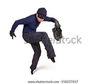 thief walking on tiptoe - stock photo