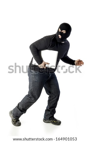thief with laptop on white background - stock photo