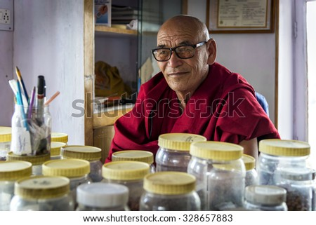 Thiksey, Ladakh - August 16, 2015: View of the herbalist monk of Thiksey monastery sitting in his laboratory. Some monks do become skilled in herbal medicine and other traditional therapies. - stock photo