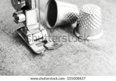 Thimbles and the sewing machine. - stock photo