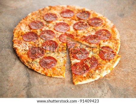 Thin Crust Pepperoni Pizza - stock photo