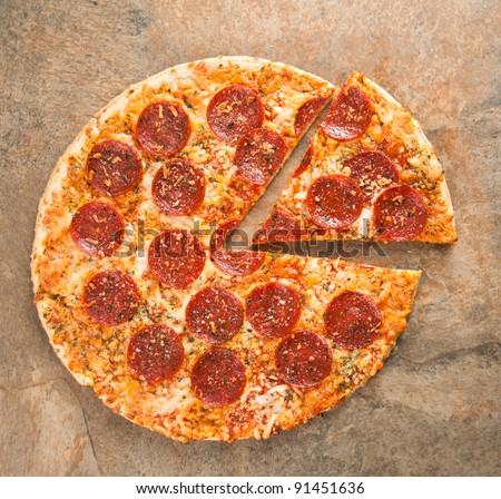 Thin Crust Pepperoni Pizza - stock photo