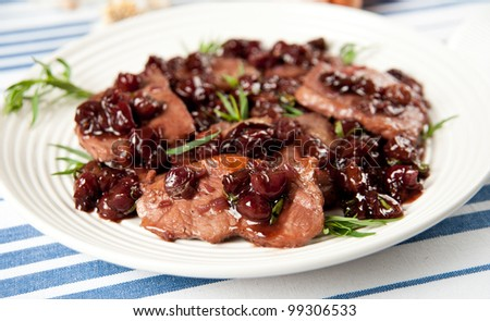 Thin Cut Pork Chops Cooked with Grapes and in Red Wine Sauce - stock photo