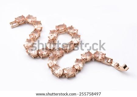 thin gold bracelet on a white background - stock photo