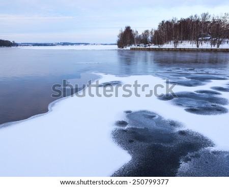 Thin ice at lake - stock photo