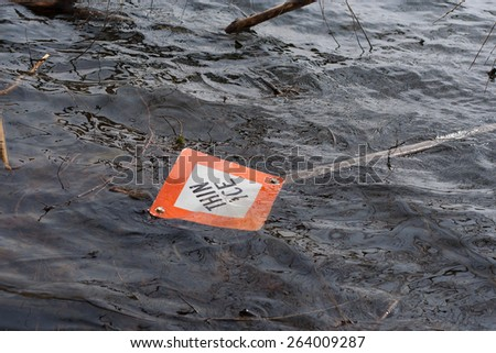 Thin Ice sign in water on lake - stock photo