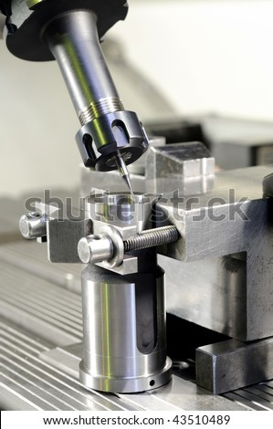 Thin mill cutting the metal blank fixed in attachment - stock photo