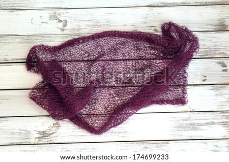 Thin purple mohair handknit scarf - stock photo