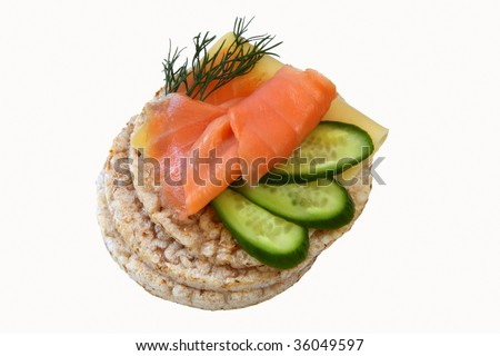 thin rice cakes with smoked salmon and cheese and vegetables isolated on white background - stock photo