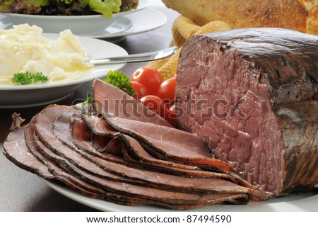 Thin sliced slow cooked roast beef with mashed potatoes and salad - stock photo