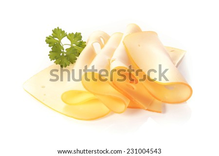 Thin slices of fresh tasty Dutch gouda cheese folded and displayed on a white background with fresh parsley - stock photo